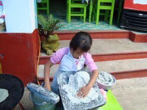 Girl kneading dough for corn tortillas Photo Credit: Fergar via Wikimedia Commons