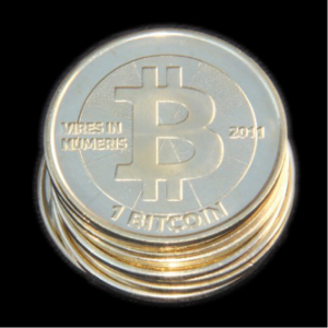 A 'real' bitcoin minted in 2011.  One significant advantage of using bitcoins in virtual transactions over credit cards is that the cost of the transaction is significantly lower.  On the coin it says in Latin 'Strength in numbers.'  Courtesy of http://www.wikipedia.com